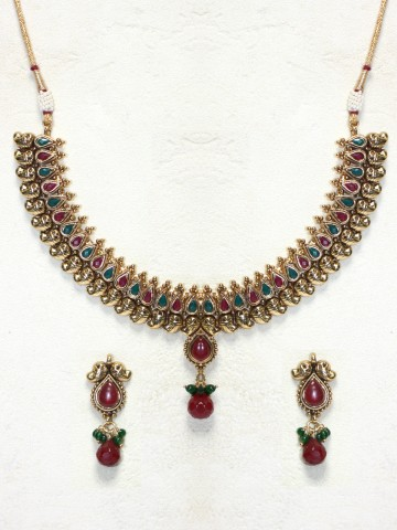 https://static7.cilory.com/43462-thickbox_default/elegant-polki-work-necklace-set-carved-with-stone-and-beads.jpg
